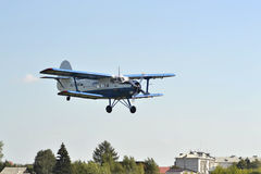 Over the city the An-2 Plane belonging to UTair airline flies. 8 Stock Photo