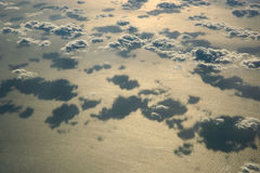 Over clouds. Storm clouds on sunrise. View from airplane Royalty Free Stock Photography