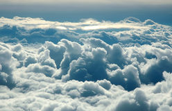 Over clouds. Storm clouds on sunrise. View from airplane Stock Photos