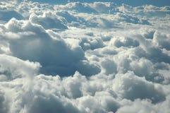 Over clouds Stock Photos