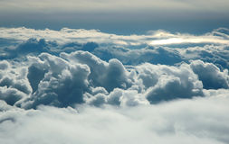 Over clouds. Storm clouds on sunrise. View from airplane Royalty Free Stock Images