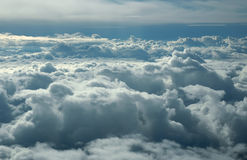 Over clouds. Storm clouds on sunrise. View from airplane Stock Image