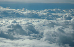 Over clouds. Storm clouds on sunrise. View from airplane Stock Images