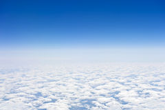 Over the clouds. Aerial view from the airplane over the clouds Royalty Free Stock Image