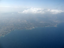Over the clouds. Aerial view after take off from Greece, sea, sky and clouds Royalty Free Stock Photography