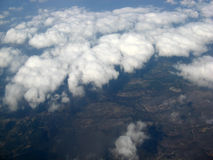 Over the clouds. Aerial view after take off from Greece. Sky, clouds and earth Stock Image