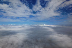 Over the clouds. Clouds out of an aeroplane window Royalty Free Stock Photo