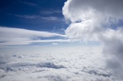 Over the clouds. Aerial view over the clouds during climbing on mountain Stock Images