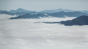 Over the clouds and fog among mountain summits landscape Royalty Free Stock Images