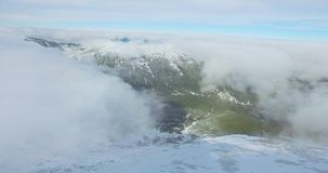 Over the clouds in the mountains stock video footage