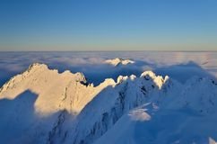 Over clouds in Tatra. Winter Tatra Mountains in Polish royalty free stock photo