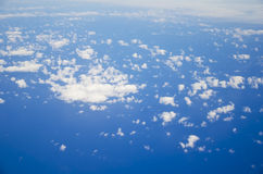 Over clouds. This is the view from an airplane on Clouds from above at 30000 feet Stock Photo