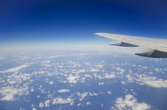 Over clouds. This is the view from an airplane on Clouds from above at 30000 feet Stock Image