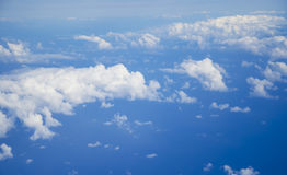 Over clouds. This is the view from an airplane on Clouds from above at 30000 feet Stock Images