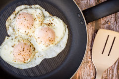 Over-easy eggs with fresh slasa and coffee Royalty Free Stock Photos