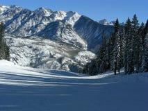 Over the Edge. Proceeding to a precipitous drop in the snowy Colorado Rockies stock photos