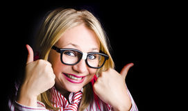 Grinning Geek With Thumbs Up To Cheeky Business Royalty Free Stock Photos