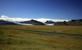Over the fields to the glacier. Looking over the fields to the glacier Iceland Royalty Free Stock Image