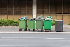 Over filled Wheelie bins, waste containers full of trash on foot Stock Photos