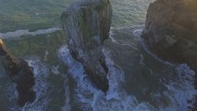 Over flying Stack Rocks on the Pembrokeshire Coast stock video footage