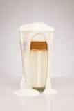 Over foaming latte macchiato Stock Images