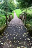 Over foot bridge Witley Court garden. Over foot bridge in Witley Court garden. Leaves on dhe ground Royalty Free Stock Photos