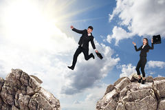 Over gap. Image of young businessman jumping over gap Stock Photo