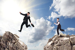 Over gap. Image of young businessman jumping over gap Stock Image