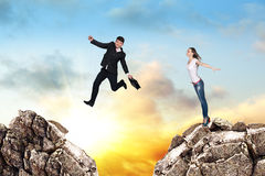 Over gap. Image of young businessman jumping over gap at the sunset Royalty Free Stock Images