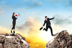 Over gap. Image of young businessman jumping over gap at the sunset Royalty Free Stock Photos