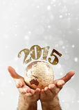 2015 over the globe earth hold by man`s hands Stock Images