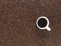 Over head cup of coffee and whole beans Royalty Free Stock Images