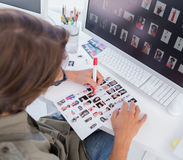Over head of editor marking contact sheet Stock Photography