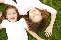 Over head portrait sisters. Royalty Free Stock Images