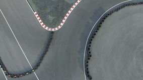 Over head view of man riding motorcycle on racing track stock video