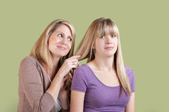 Over Involved Mother with Annoyed Daughter Stock Image