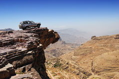 Over land. Lone car is standing on rock over breakaway Royalty Free Stock Photo