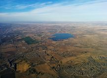 Over lands and lakes. Flying over land, lake, city, and fields Royalty Free Stock Image