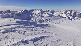 Over The Lift Aerial 4k. Aerial of lifts in Les Deux Alpes, France. This is a 4k video stock video footage