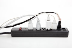 Over loaded surge protector. An over loaded black surge protector on a white background stock photo