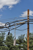 Over loaded utility pole Stock Photos