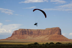 Over Monument Valley. A powered paraglider pilot in flight over Monument Valley Stock Images