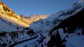 Over the mountains and road. Over the mountains. aerial. Transfagarasan Landscape with snow stock video