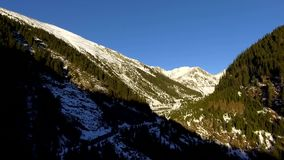 Over the mountains and road. Over the mountains. aerial. Transfagarasan Landscape with snow stock footage