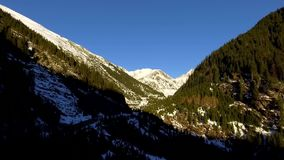 Over the mountains and road. Over the mountains. aerial. Transfagarasan Landscape with snow stock video footage