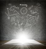 Over an open book drawn sketches business Royalty Free Stock Images