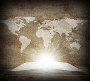 Over an open book is a map of the earth Stock Images