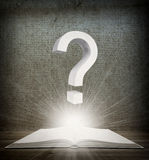 Over an open book is question mark Royalty Free Stock Photos