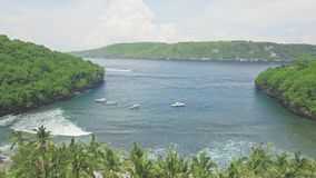 Over Palms Beutiful Snorkeling Bay Coral Reef Tropical Aerial 4k. Aerial footage of a beautiful snorkeling bay with shallow water in Nusa Penida, Indonesia stock footage