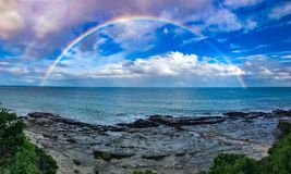 Over the Rainbow. Somewhere across the ocean there's a rainbow waiting for Royalty Free Stock Images